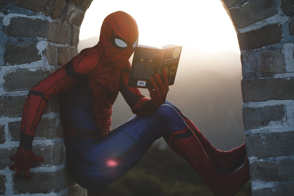 Spiderman reading in the window