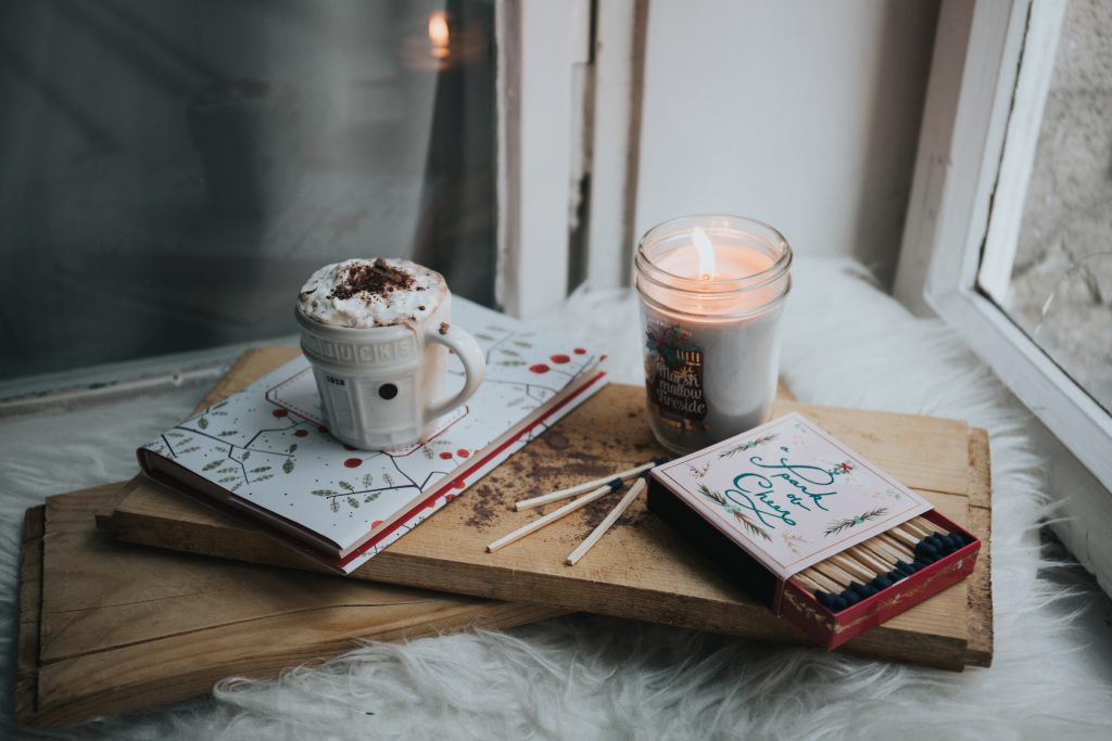 cozy drinks and matches by a window